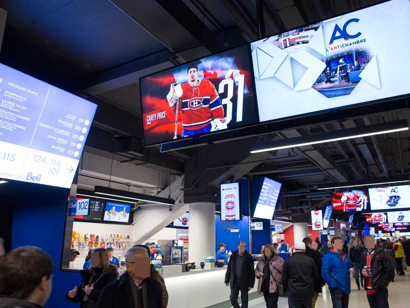 stadium_bell-center-montreal-corridor-multi-diaplays-wayfinding-powered-by-navori-ql-software